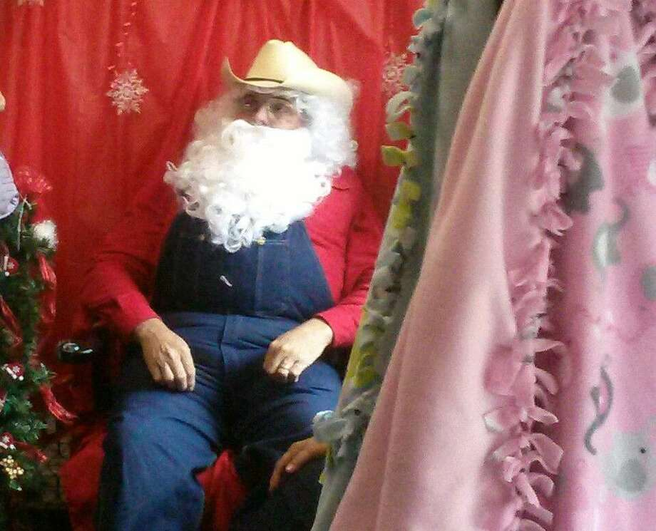 Country Santa sits at the Crosby Antique Mall's Christmas in Old Town Crosby, waiting to greet children at the event held on Saturday, Dec. 12.