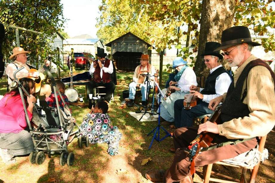 Wunderlich Farm visitors enjoying live music at the Old Fashion Christmas Market that was held on Saturday, Dec. 5.