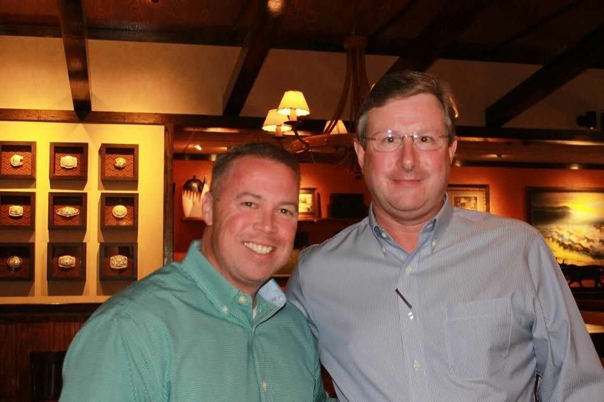 Montgomery County Precinct 3 Constable Ryan Gable and Longhorn Steakhouse Managing Partner Billy Banks at a recent fundraiser for Children's Safe Harbor.