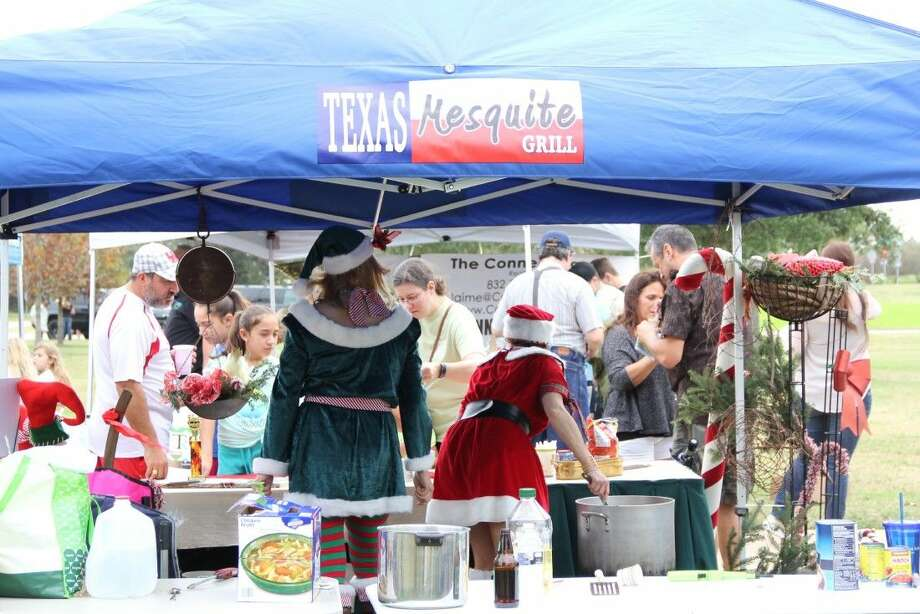 Contestants share their chili with the public during Bridgeland's seventh annual Chili Cook-Off on Saturday, Dec. 12. Photo: Vagney Bradley