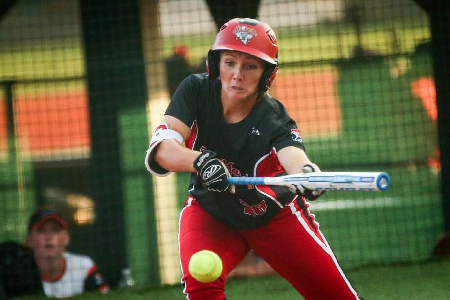 Emilee Koerner of the Scrap Yard Dawgs hits a sacrifice bunt to bring home a run against the Chicago Bandits on Tuesday.
