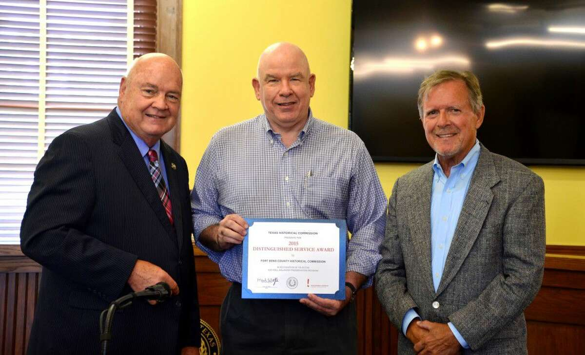 Fort Bend County Judge Bob Hebert, and Fort Bend County Historical Commission members/volunteers Charles Kelly and Don Brady. Hebert recently recognized the Commission for their efforts in 2015.