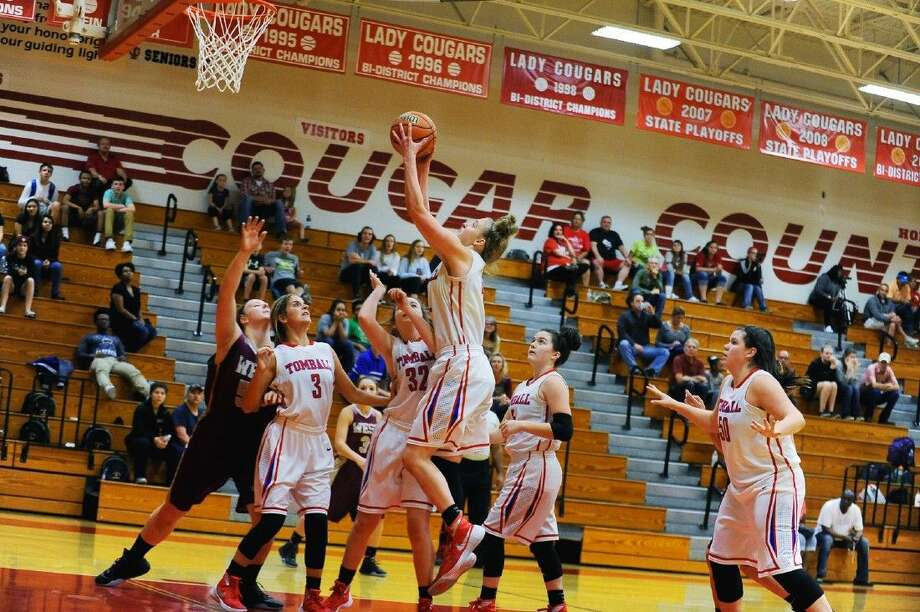 Tomball senior post Bethany Petch goes up to score against Magnolia West at Tomball High School Friday, December 11, 2015. Petch scored 17 in the victory, the first district game for both teams. Photo: Tony Gaines
