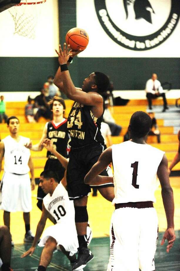 Northland Christian senior center Chris Edwards goes up strong against the Northbrook defense Friday, December 4, 2015 in the Spring Branch ISD Tournament. Edwards scored 19 points in the loss. Photo: Tony Gaines