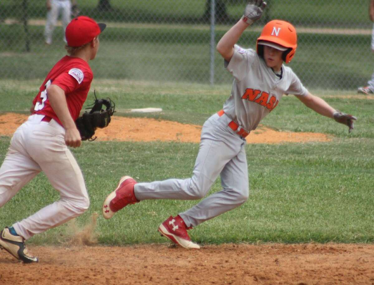 NASA ballplayer Christian Whitehead finds himself hung up between first and second base during Sunday morning's game with League City. Let's see if he made his Clear Lake Space Raiders experience pay off and got away from the tag...