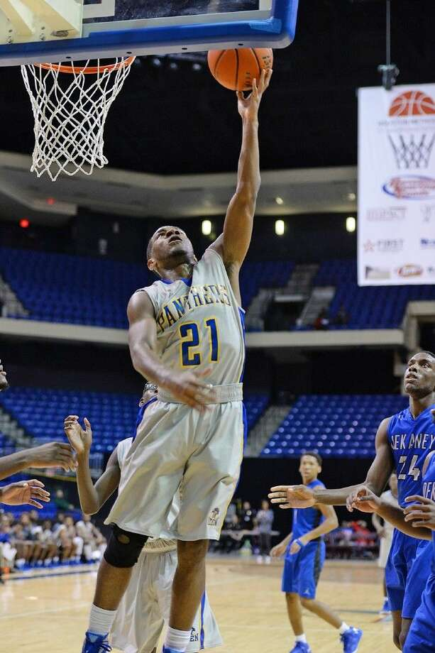 Beaumont Ozen senior guard John Comeaux scores two of his 38 points against Dekaney Saturday, December 12, 2015 in the Cy Hoops finals at the Berry Center. Comeaux was awarded Tournament MVP honors, and the Panthers won their second straight Cy Hoops championship. Photo: Photo C/O Joel Weckerly, CFISD