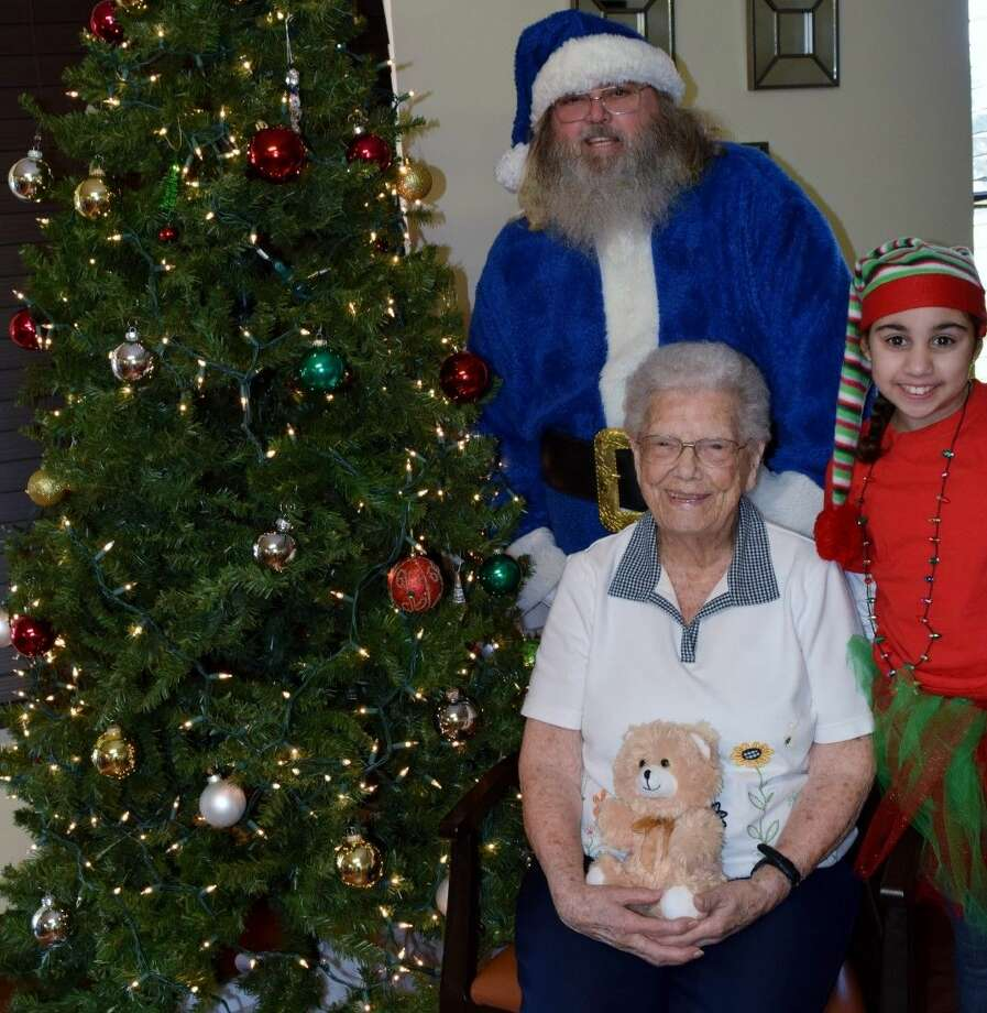 Blue Santa and his elf visit with Jan Culver. Photo: Submitted