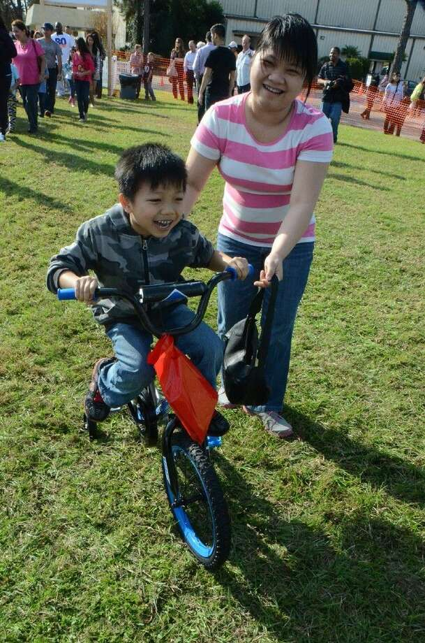 Frazier student and his mother test out a new bicycle given by Faith Assembly Church. Photo: Submitted Photo