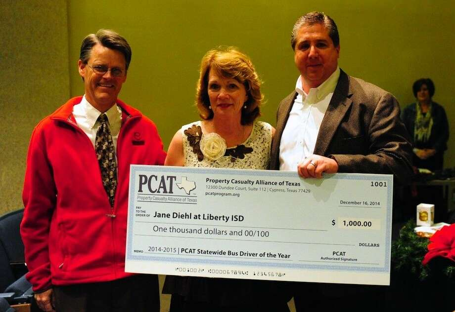 Jane Diehl was named PCAT Statewide Bus Driver of the Year and received a $1,000 check from PCAT's Neil Gately, at left, and Tom Linklater from NAS Risk Management.
