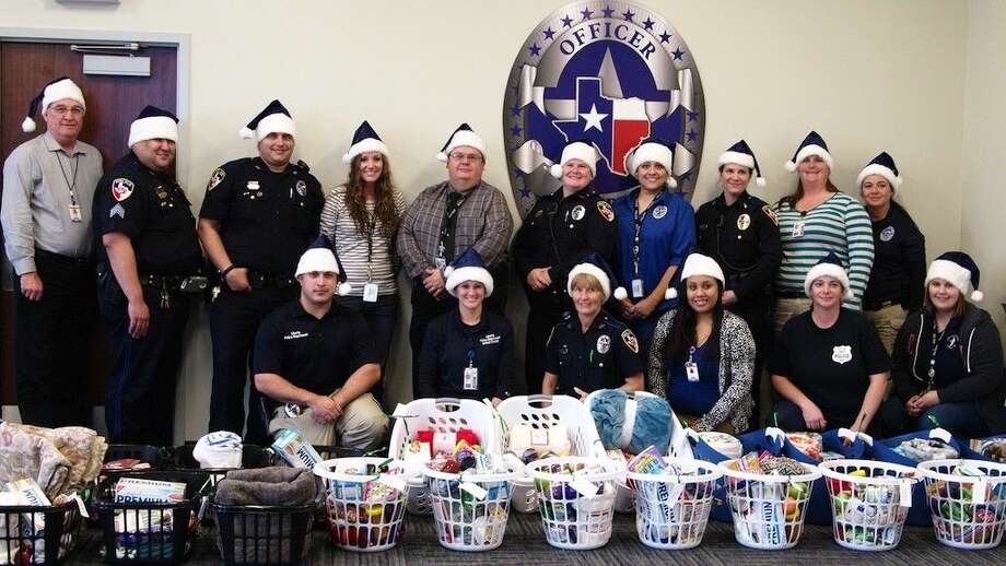 The officers of the Liberty Police Department are once again delivering food, blankets, and other items to local senior citizens who could use a little help. This year their Silver Santa program delivered 22 laundry baskets filled with donations. Photo: Casey Stinnett