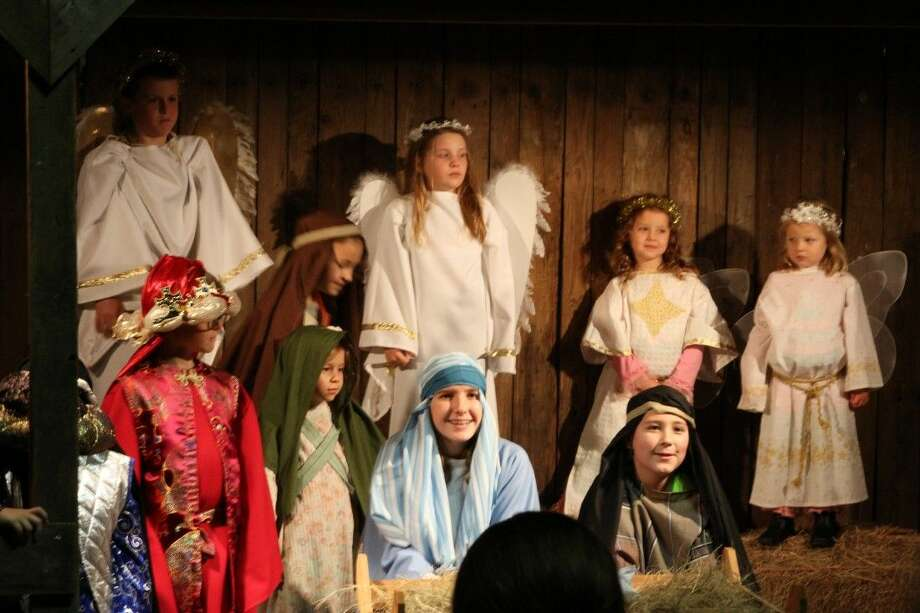 Members of Good Shepherd Episcopal Church in Kingwood perform a Live Nativity for guests on Thursday, Dec. 18, 2014.