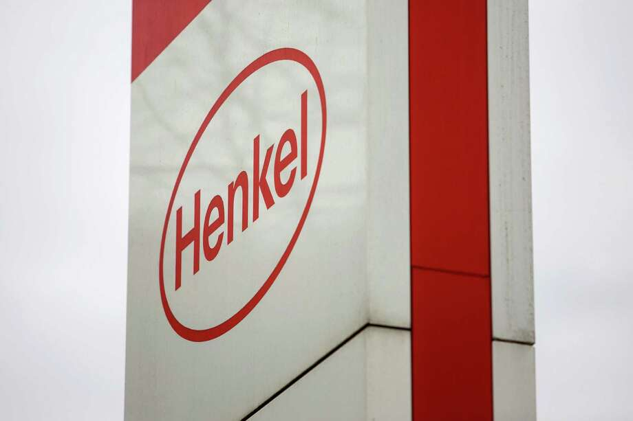 The Henkel AG logo sits on a sign outside the companys headquarters and factory in Duesseldorf, Germany. Photo: Krisztian Bocsi / Bloomberg / © 2016 Bloomberg Finance LP