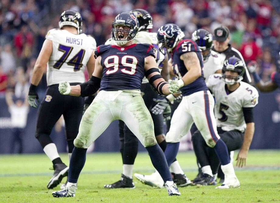 Houston Texans defensive end J.J. Watt celebrates after sacking Baltimore Ravens quarterback Joe Flacco in the fourth quarter of an NFL football game Sunday, Dec. 21, 2014, in Houston. Photo: Jason Fochtman