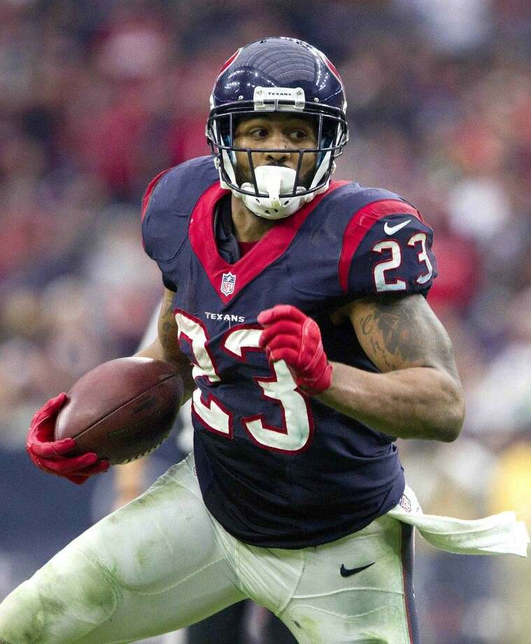 Houston Texans running back Arian Foster runs the ball in the second quarter of an NFL football game, Sunday, Dec. 21, 2014, in Houston. Photo: Jason Fochtman