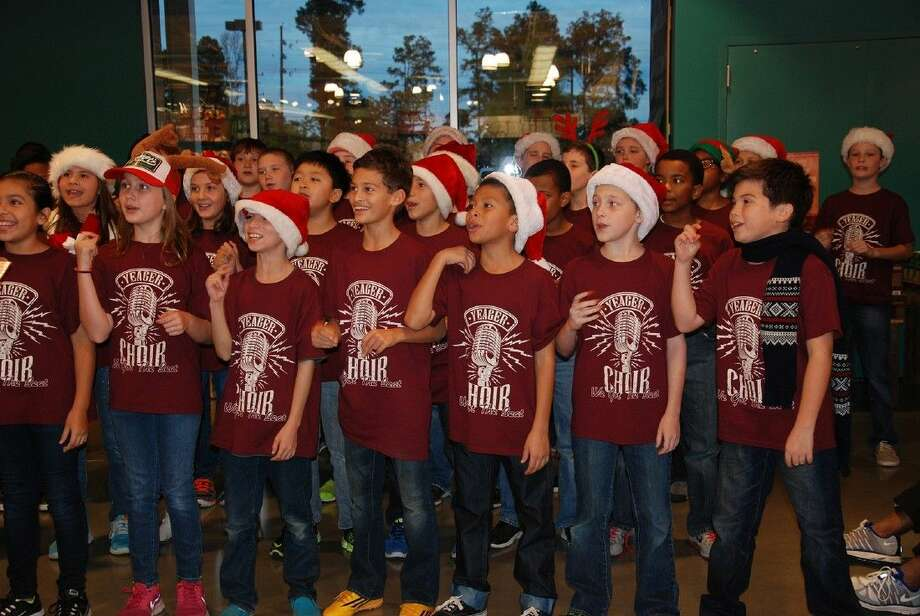 """The Yeager Elementary School choir performs at Whole Foods Vintage Park on Dec. 11. Proceeds from the """"5% Day"""" sales benefited district partner Cy-Hope. Photo: Submitted Photo"""
