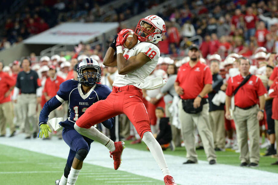 Katy's J.C. Angulo makes a catch during the Tigers' 35-17 victory against Manvel in the Class 6A Division II regional finals Dec. 4 at NRG Stadium in Houston. The Tigers play Lake Travis for their eighth state title Dec. 19 at NRG Stadium. To view or purchase this photo and others like it, visit HCNpics.com. Photo: Craig Moseley