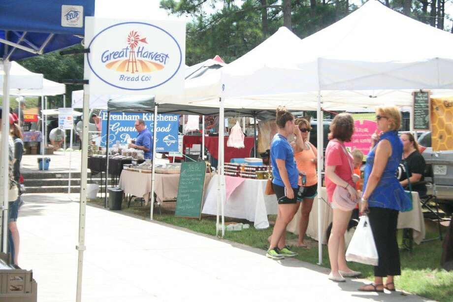 The Kingwood Farmers Market convenes every Thursday evening at Town Center Park.
