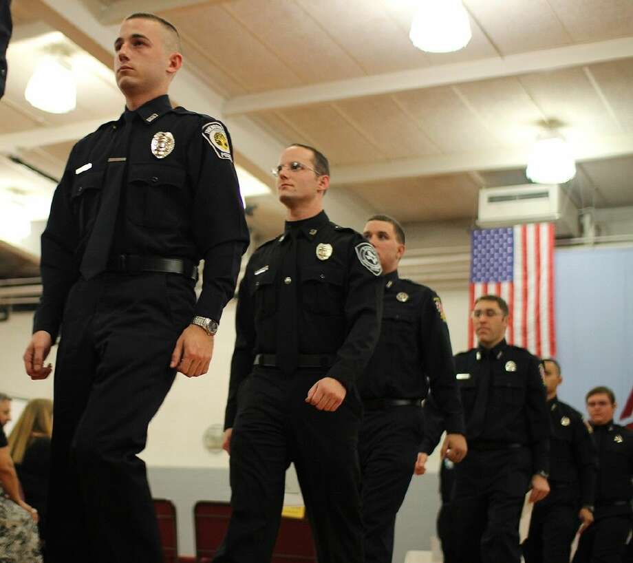 ACC Law Enforcement Academy cadets march after receiving their degrees during a graduation ceremony on December 11.