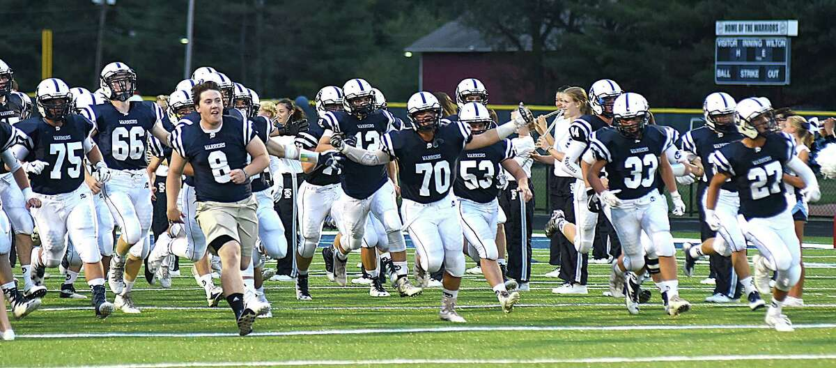 Action from Friday's season-opening FCIAC football game between host Wilton and visiting Fairfield Warde at Fujitani Field in Wilton on Sept. 9, 2016.