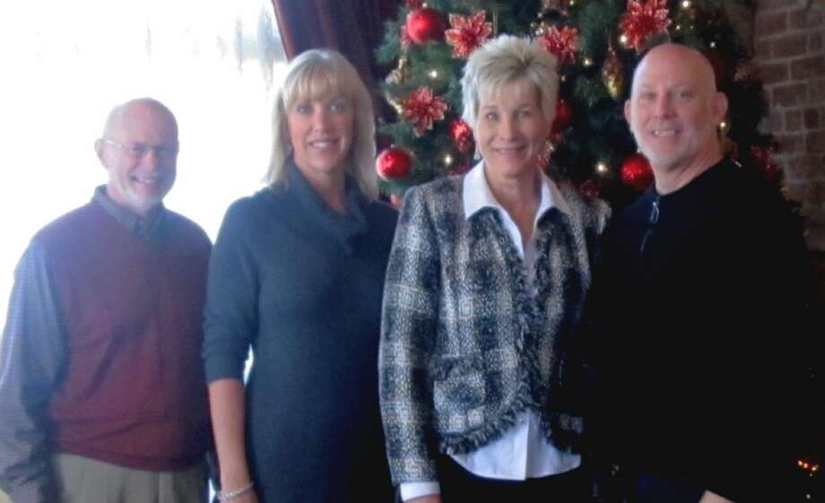 The 2014 Friends of Devereux Appreciation Luncheon was a chance for friends to gather and enjoy the holiday spirit. Pictured, from left, are Devereux Texas Advisory Board member Bob Reeves, Devereux Texas Director of Development Joni Robertson, Lisa Howard and Devereux Texas Chairman Roy Green.