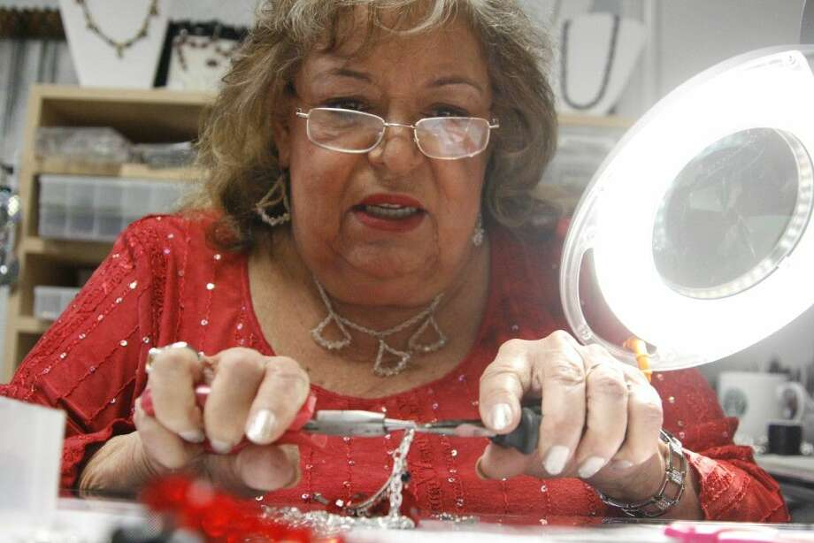 Barbara Hamlett creates a one-of-a-kind piece of jewelry at her business, Classi Ladi Custom Jewelry, in Porter. Hamlett notified customers that will be closing down at the end of the year in order to prepare to move to Tennessee.