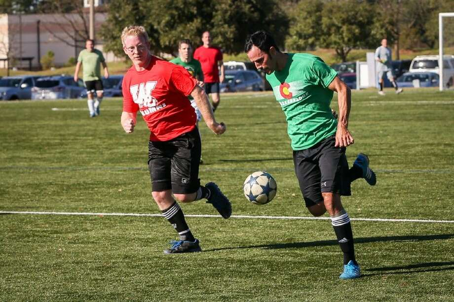 The Woodlands High School soccer team alumni, split into red and green teams, compete against one another on Saturday, Dec. 19, 2015, at Bear Branch Sportsfields.