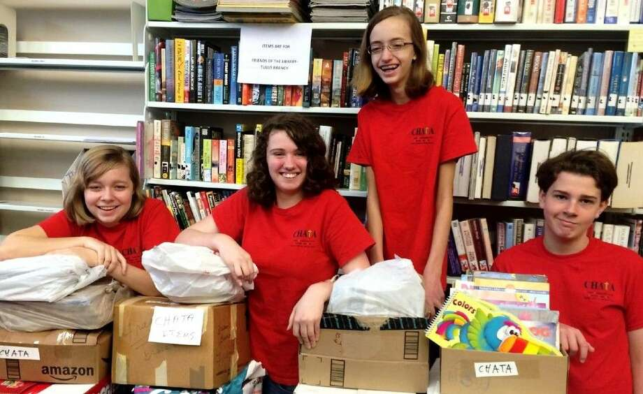 Members of CHATA (Christian Homeschoolers Atascocita Texas Area), including Rachel Boyd, Heather Shipman, Katherine Boyd and Andrew Shipman, recently helped with a book drive for the Friends of the Library organization at R.B. Tullis Branch Library in New Caney. Photo: Stephanie Buckner