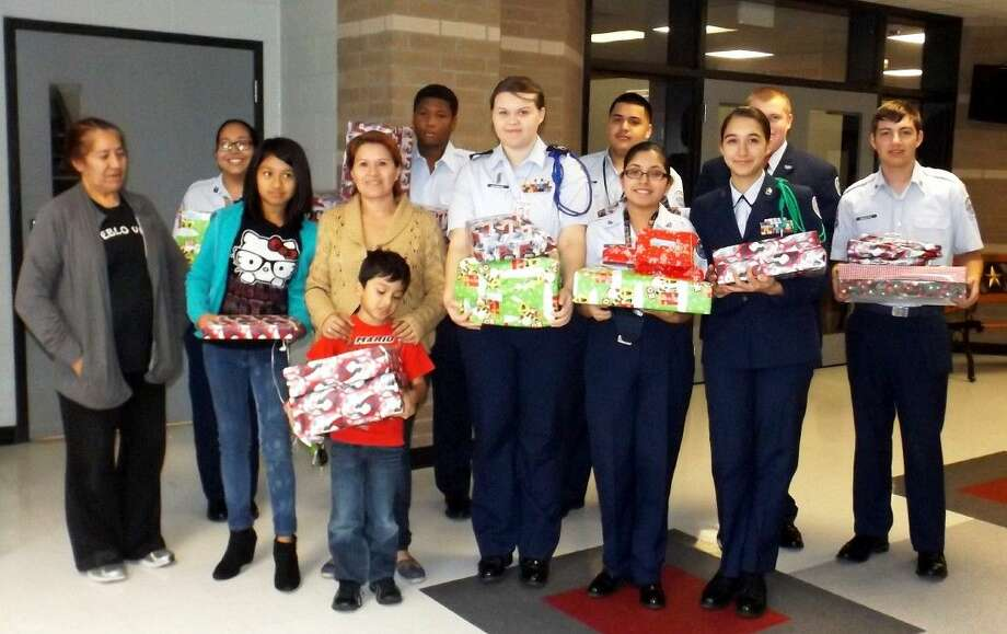 Members of the Cleveland High School JROTC delivered gifts to local families to spread joy for the holiday season. Photo: Submitted