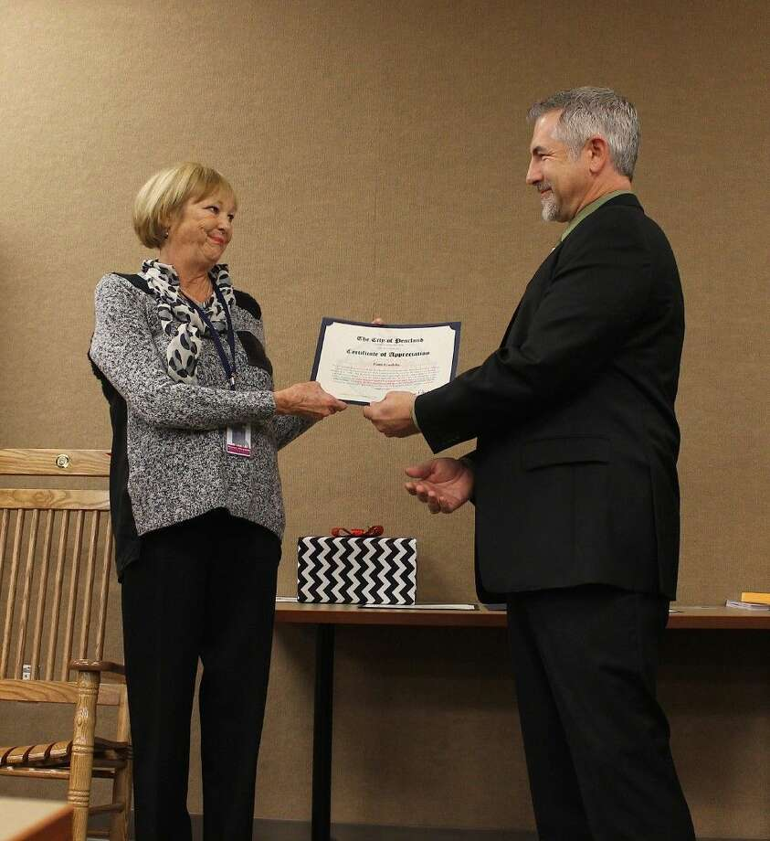 Patty Goolsby receives a Certificate of Appreciation from Asst. City Manager Trent Epperson.