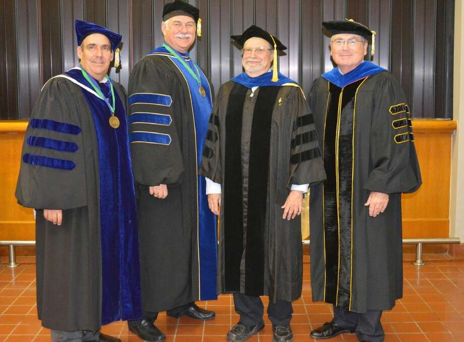 Pictured (l to r) are Senior Vice President for Academic Affairs and Provost Carl A. Stockton, School of Human Sciences and Humanities Dean Rick Short, Malin and President William A. Staples.