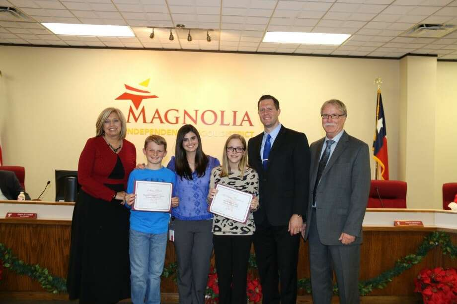 Students of the Month: Principal of Magnolia Elementary School Linda Kenjura with Jackson Bland, Lindsay Borras from Emerus Community Hospital of Tomball, McKenna Castleberry with Principal Dr. Ben King of Bear Branch Junior High and School Board President Steve Crews. Photo: MISD