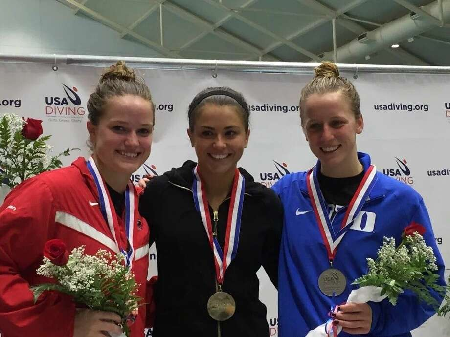 Kassidy Cook, center, a graduate of The Woodlands High School, won the women's 3-meter springboard final with a total score of 975.20 at the USA Diving Winter National Championships in Indianapolis.
