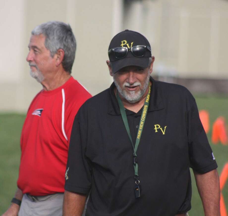 Russell Hancock, in the red Bondy shirt, with his laid-back attitude along the sidelines, had a terrific relationship with opposing coaches such as longtime Park View coach Elton Blanchard as seen in a football game last fall. Photo: Robert Avery