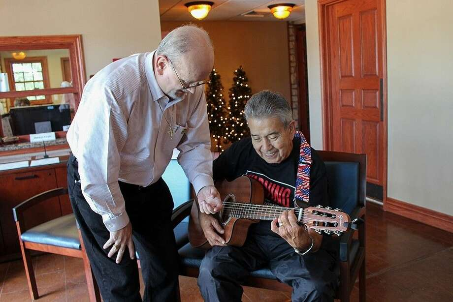 Richard Robbins gives a guitar lesson at Precinct 4's Big Stone Lodge at Dennis Johnston Park.