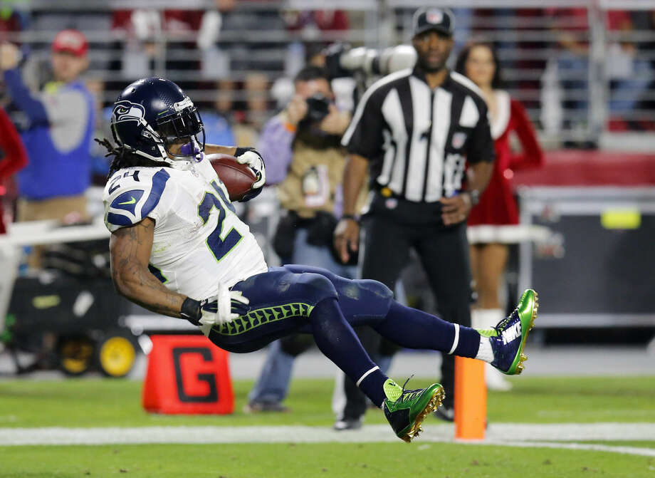 Seattle Seahawks running back Marshawn Lynch leaps into the end zone for a touchdown against the Arizona Cardinals during the second half of an NFL football game, Sunday, Dec. 21, 2014, in Glendale, Ariz. (AP Photo/Rick Scuteri) Photo: Rick Scuteri