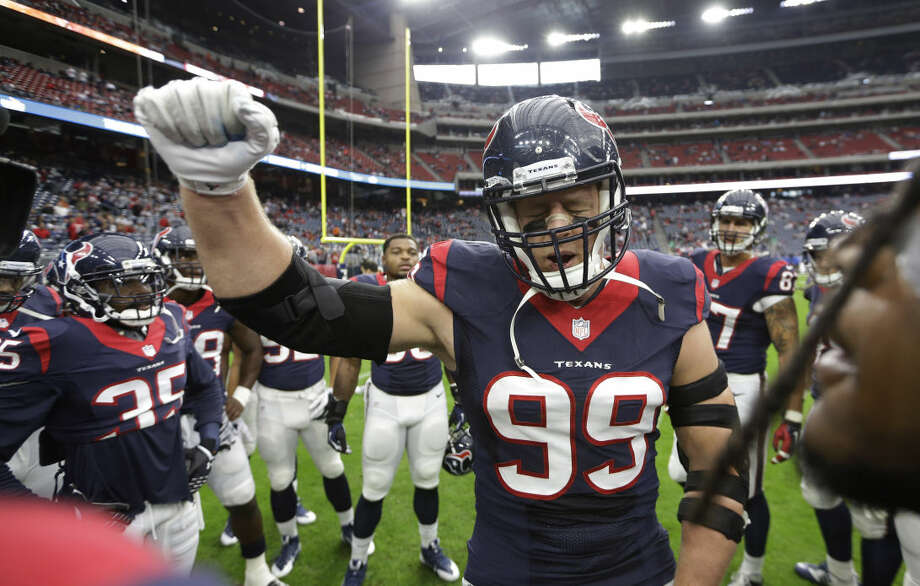 Houston Texans defensive end J.J. Watt (99) cheers in the huddle before an NFL football game against the Baltimore Ravens Sunday, Dec. 21, 2014, in Houston. (AP Photo/David J. Phillip) Photo: David J. Phillip