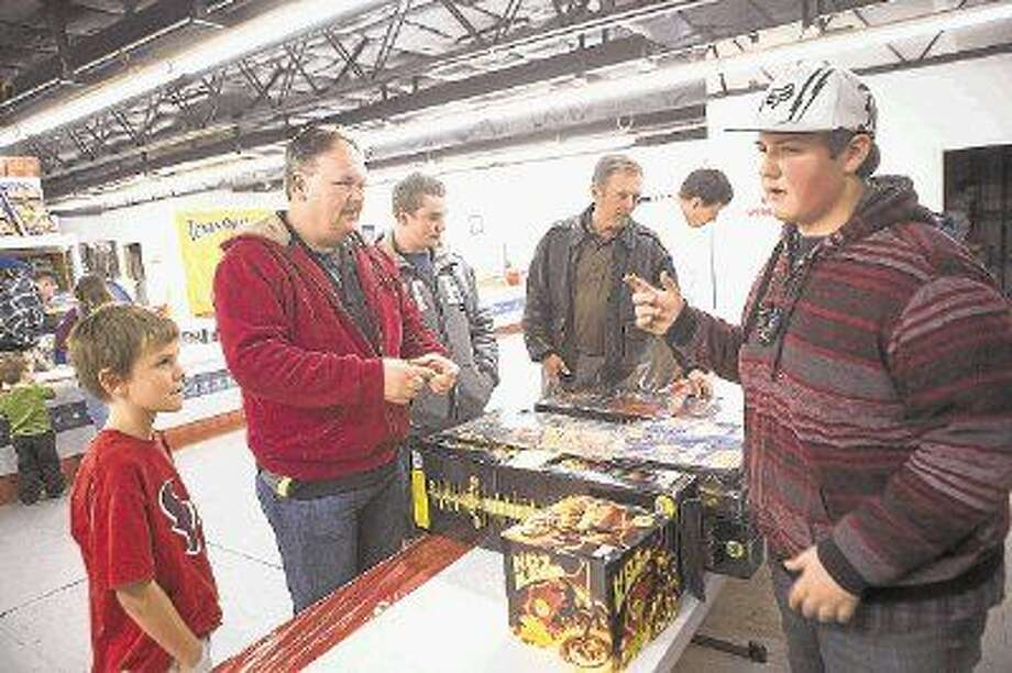 Devon Burnett, right, helps George Hahn finds specific fireworks while preparing for New Years Eve festivities last year at the 1960 Fireworks Supercenter in Humble. Photo: ANDREW BUCKLEY