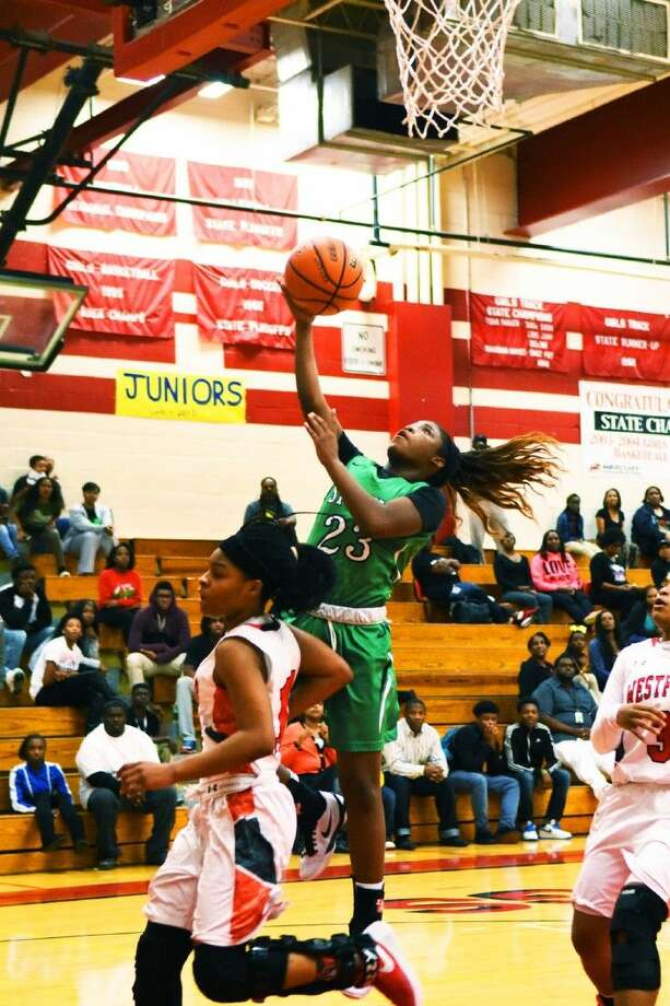 Spring sophomore guard Deneisa Johnson hits a layup against the Lady Mustangs at Westfield High School, Tuesday, December 15, 2015. Johnson scored 18 points in the rivalry district matchup, leading all scorers. Photo: Tony Gaines