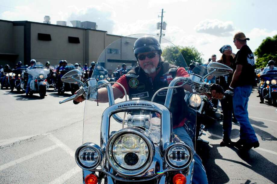 "Freedom Cruisers Riding Club Officer John Chance waits with other riders for the start of the ""Support the Blue"" motorcycle ride with riding clubs in and around Houston wearing blue and circling Houston to show support for police officers across the state Saturday, July 16. Photo: Kirk Sides"
