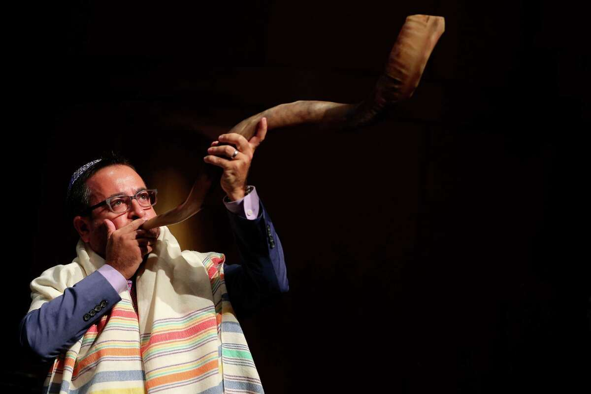 Josh Fields blows the shofar during the Temple Sholom family Rosh Hashanah service in the auditorium of Greenwich High School in Greenwich, Conn. on Monday, Oct. 3, 2016.