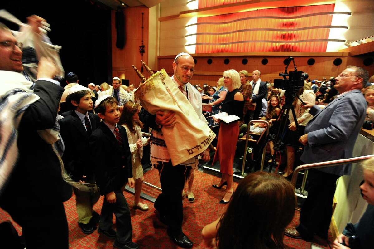 The Torah gets walked around the Greenwich High School auditorium during the Temple Sholom family Rosh Hashanah service in Greenwich, Conn. on Monday, Oct. 3, 2016.