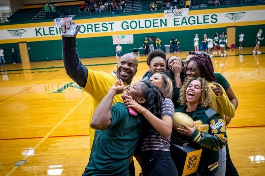 Klein Forest High School alum Steve Jackson, former National Football League Coach and Player, returned to his home campus bringing words of wisdom and a Golden Football. Photo: Submitted