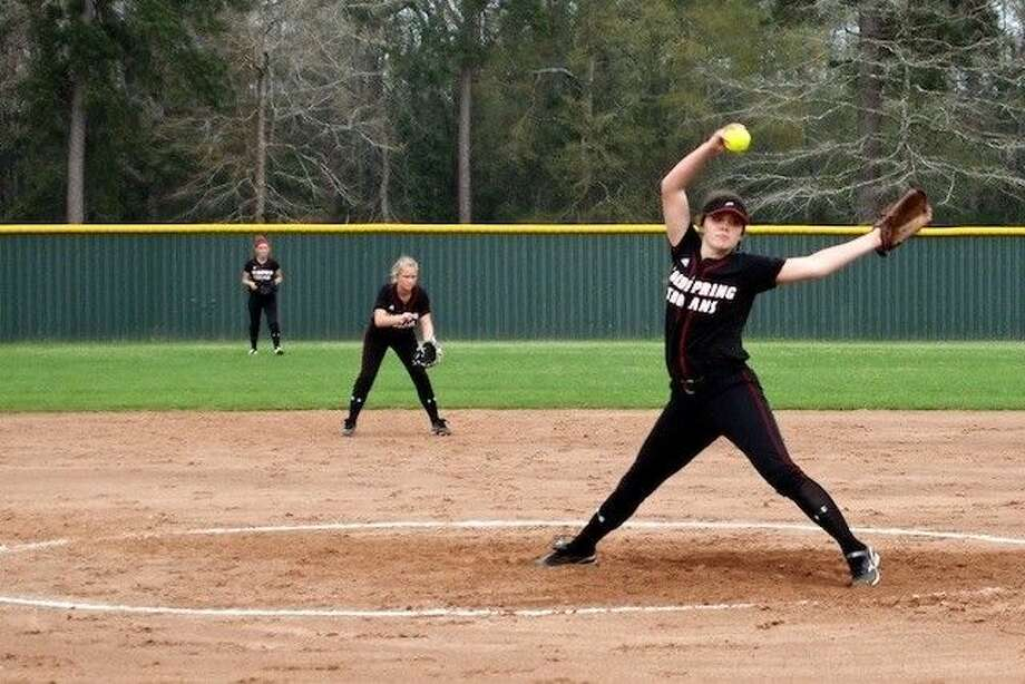 Jessica Lyle pitched for the Trojans against Splendora's Ladycats on Friday, March 28, in a game that was rained out in the sixth, but will be made up Wednesday, April 2. Also shown is Brenna Wolsey at second and Tiffani Huff in right field. Photo: Reporter/Sports Editor
