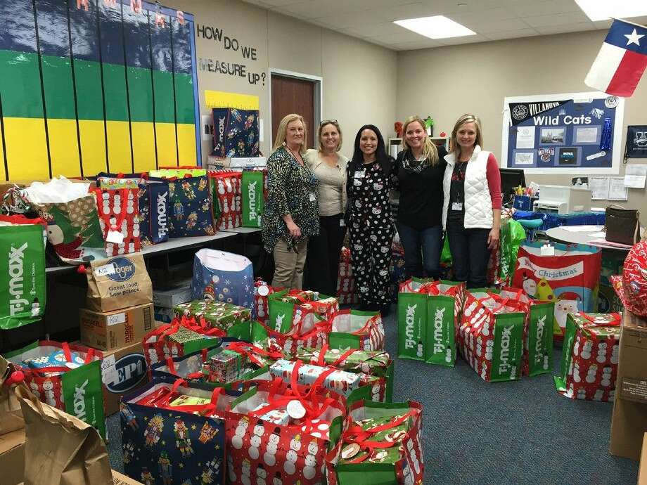 A. Robison students provided holiday gifts for 32 students at M. Robinson Elementary School. Pictured (L-R) are Sally Hall, A. Robison secretary; Kelly Gerletti, A. Robison principal; Irene Ruiz, M. Robinson principal; Courtney Nespeca, A. Robison assistant principal; and Jenny Daniell, A. Robison librarian.
