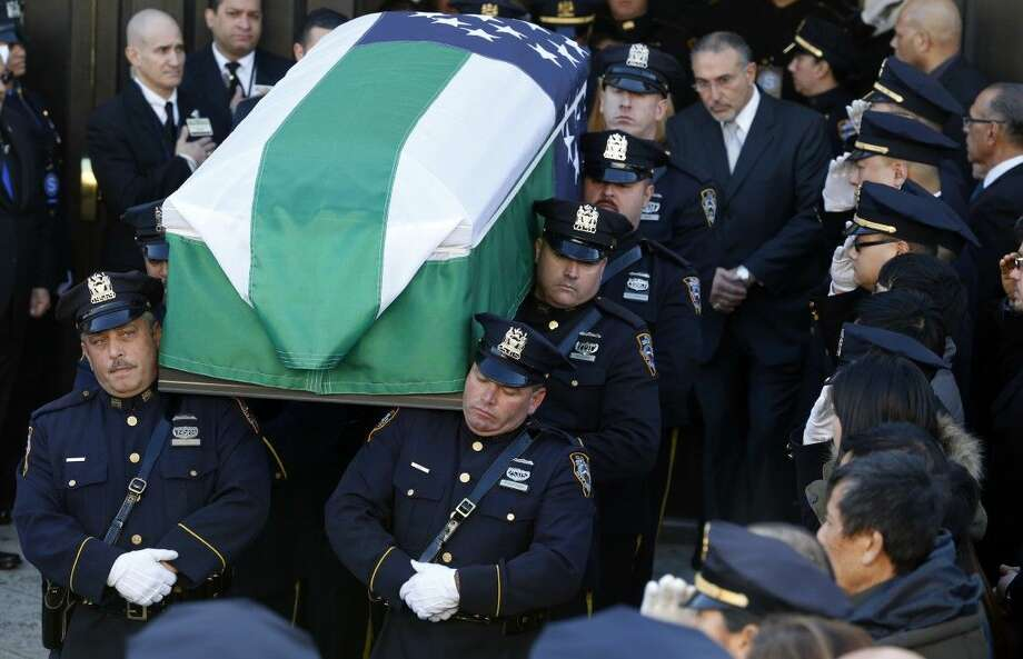 Pallbearers carry the casket of New York City police officer Rafael Ramos following funeral services Saturday at Christ Tabernacle Church in the Glendale section of Queens in New York.