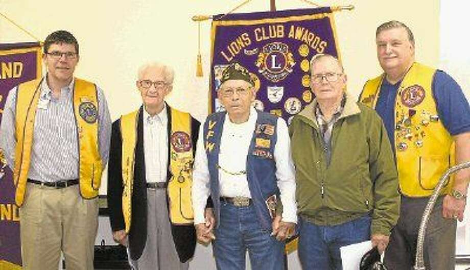 Cleveland Lions Club President Thomas Higgins (left) and club member Mike Penry (right) welcomed local World War II veterans John Wuensche, E.T. Clark and Cliff Morris during the Dec. 9 meeting. Photo: Stephanie Buckner