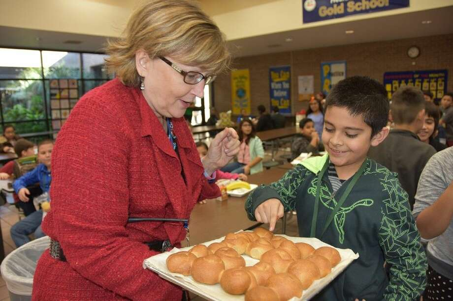 Diego Torres, fourth-grade student at Bane Elementary School, shows Dr. Carrie Marz, principal, which baked roll he wants to eat after creating them in the Bake for Good project.