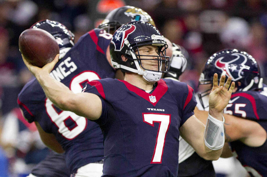 Houston Texans quarterback Case Keenum drops back to pass in the first quarter of an NFL football game Sunday. Photo: Jason Fochtman