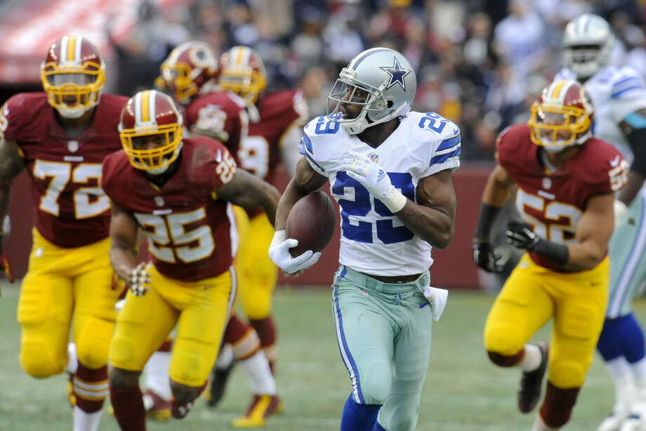 Dallas Cowboys running back DeMarco Murray (29) carries the ball during the first half of an NFL football game against the Washington Redskins in Landover, Md., Sunday, Dec. 28, 2014. Murray set the franchise single-season rushing record for the Cowboys on the play. (AP Photo/Richard Lipski) Photo: Richard Lipski