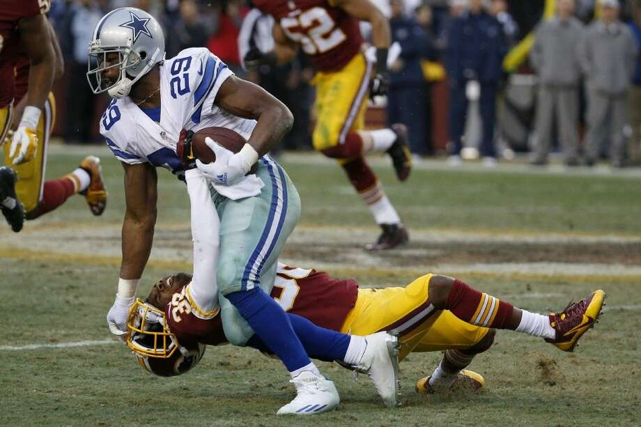 Dallas Cowboys running back DeMarco Murray pushes Washington cornerback Justin Rogers to the turf Sunday. The Cowboys won 44-17.